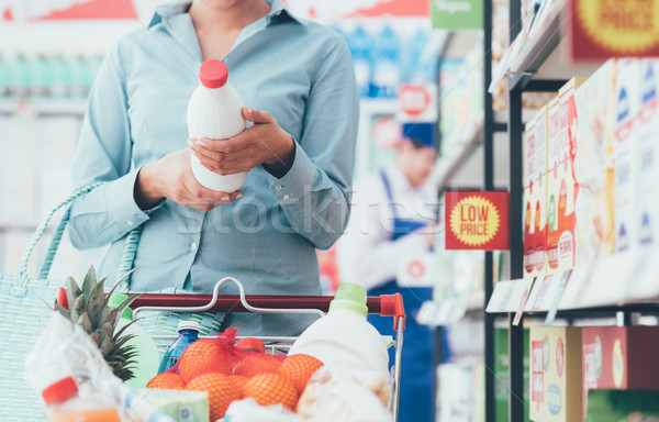 Woman reading food labels Stock photo © stokkete
