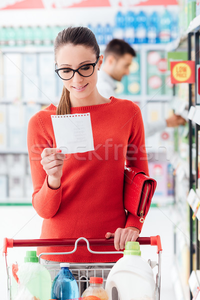Young woman shopping at the supermarket Stock photo © stokkete