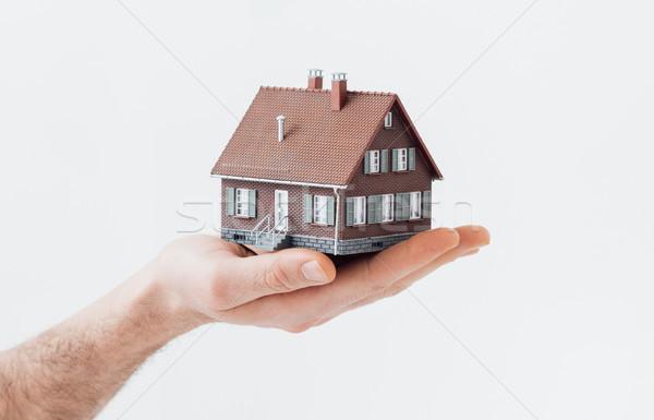 új otthon férfi tart modell ház ingatlan Stock fotó © stokkete