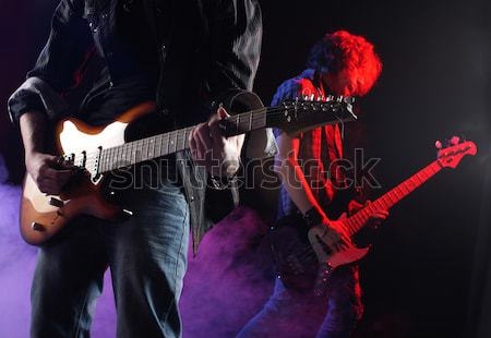 rock bassist plays his bass on a dark background Stock photo © stokkete