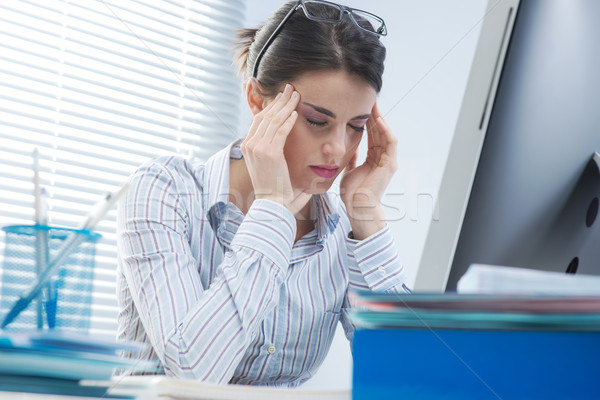 Tired businesswoman with headache Stock photo © stokkete