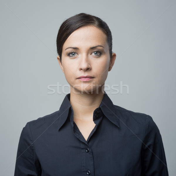 Serious woman in blue shirt Stock photo © stokkete