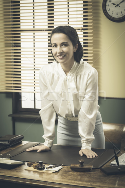 1950s business woman leaning on desk Stock photo © stokkete