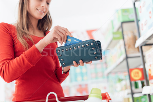 Woman at the checkout Stock photo © stokkete