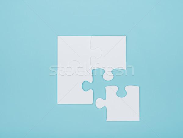 Kirakós játék darabok világoskék problémamegoldás kihívás építkezés Stock fotó © stokkete