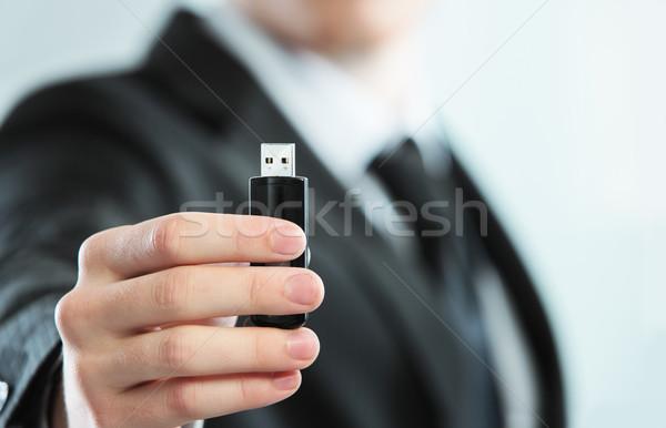 Flash drive mão empresário usb chave Foto stock © stokkete
