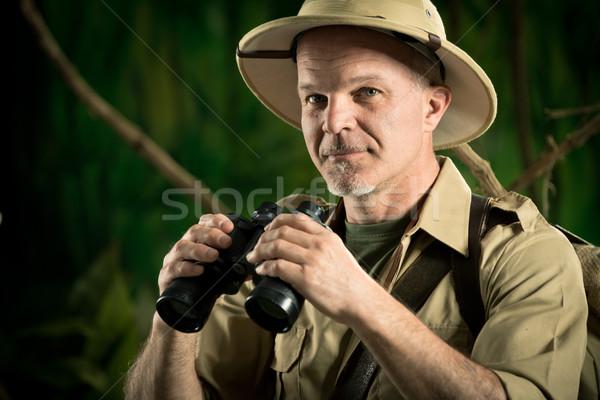 Avventuriero giungla binocolo sorridere explorer coloniale Foto d'archivio © stokkete