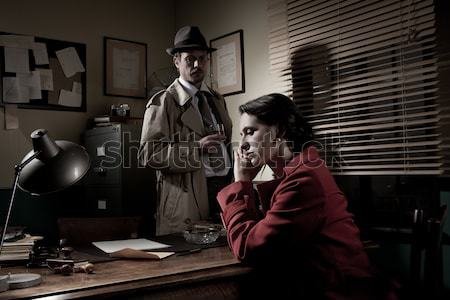 Detective protecting a young woman pointing a gun Stock photo © stokkete