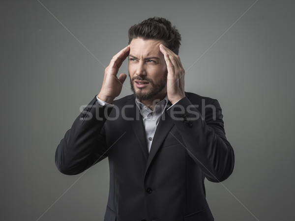 Stock photo: Businessman with headache head in hands
