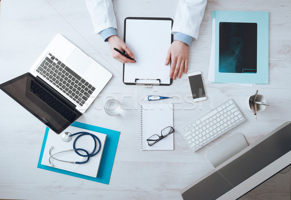 Stock photo: Doctor writing medical records