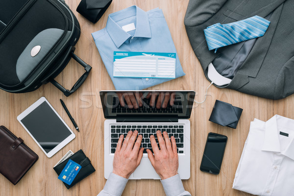 Businessman planning a business trip Stock photo © stokkete