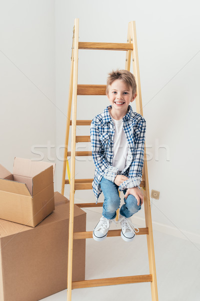 Lakásfelújítás aranyos fiatal srác ül létra mosolyog Stock fotó © stokkete