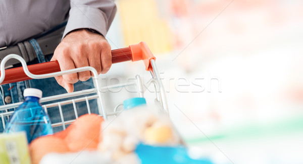 Man doing grocery shopping Stock photo © stokkete