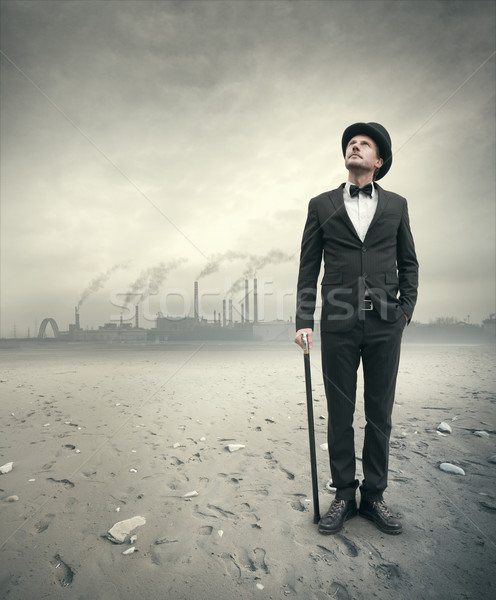 Vintage businessman in post atomic setting Stock photo © stokkete