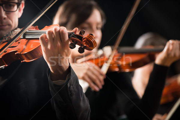 Violin orchestra performing on stage Stock photo © stokkete