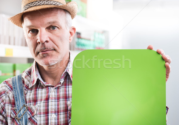 Farmer with sign at supermarket Stock photo © stokkete