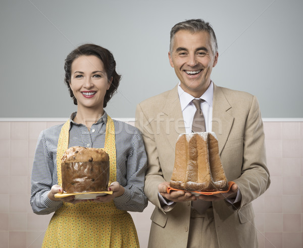Smiling vintage couple with cakes Stock photo © stokkete