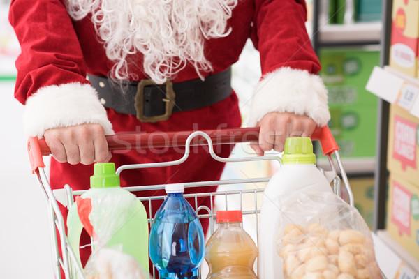 Santa doing grocery shopping Stock photo © stokkete