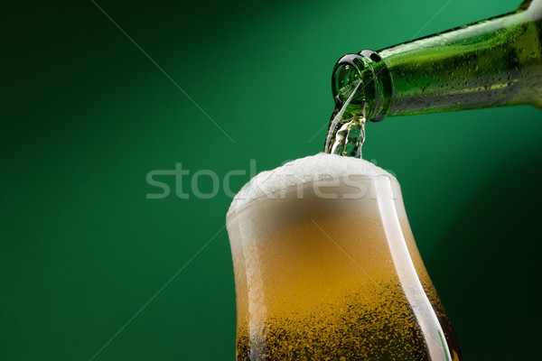 Pouring beer into a glass Stock photo © stokkete