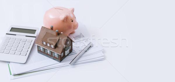 不動産 住宅ローン モデル 家 貯金 電卓 ストックフォト © stokkete