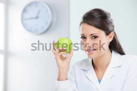 Professional nutritionist holding a fresh apple Stock photo © stokkete