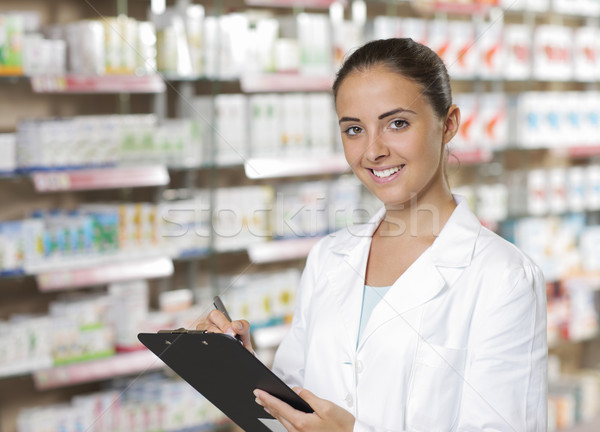 Portrait of Smiling Woman Pharmacist whit clipboard Stock fotó © stokkete
