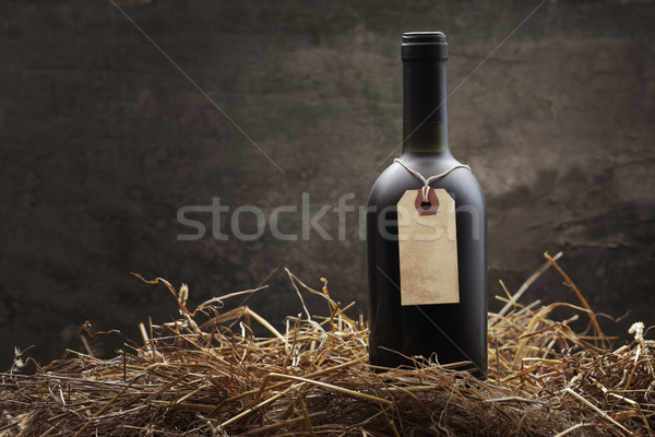 Red wine in the straw Stock photo © stokkete