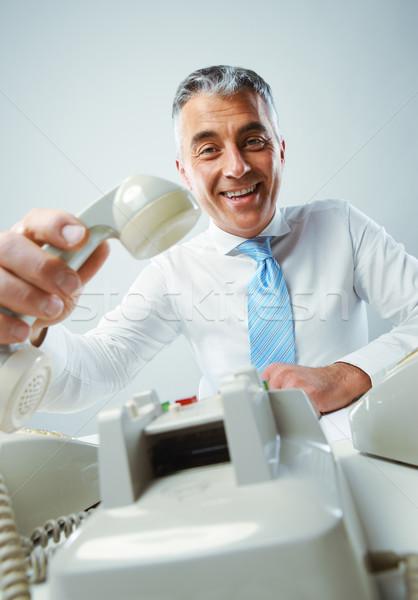 Bonnes nouvelles portrait souriant maturité homme d'affaires téléphone Photo stock © stokkete