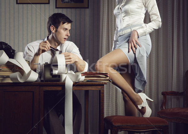 Young sexy woman shows a leg for business man Stock photo © stokkete