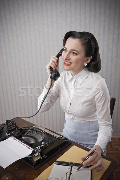 Nő beszél telefon asztal portré írógép Stock fotó © stokkete