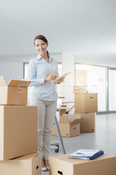 Businesswoman moving in her new office Stock photo © stokkete
