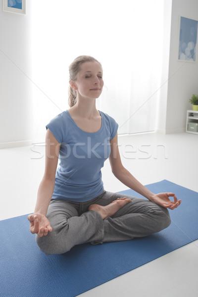 Nő lótusz pozició fiatal nő gyakorol jóga Stock fotó © stokkete