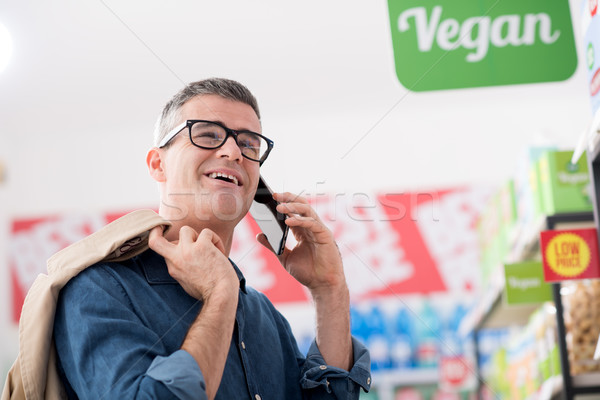 Man having a phone call at the supermarket Stock photo © stokkete