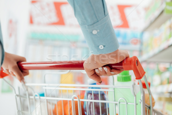 Woman pushing a shopping cart Stock photo © stokkete
