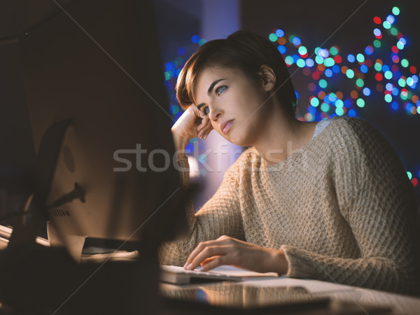 Sleepy woman connecting late at night Stock photo © stokkete