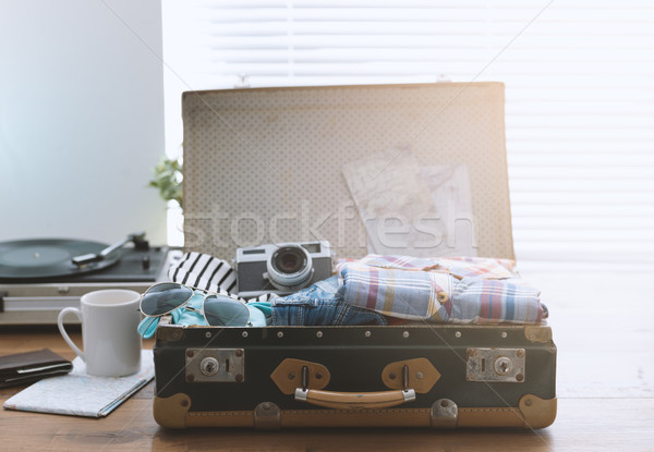 Traveler packing his suitcase before leaving Stock photo © stokkete
