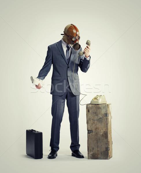 üzletember telefon telefon férfiak öltöny maszk Stock fotó © stokkete