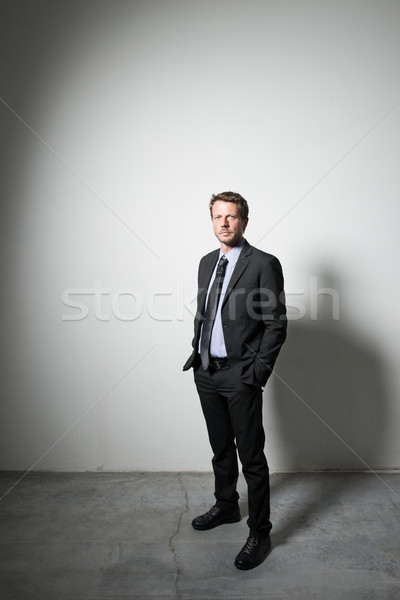 Confident businessman looking away Stock photo © stokkete