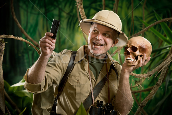 Selfie in the jungle with skull Stock photo © stokkete