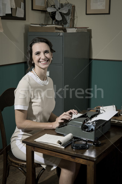 Young vintage secretary at work Stock photo © stokkete