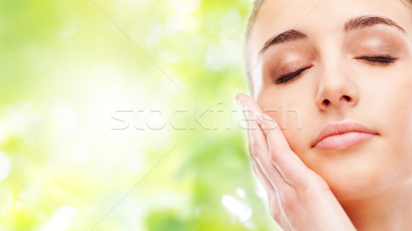 Beautiful woman touching her smooth skin Stock photo © stokkete