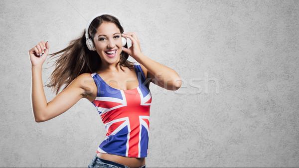 Pop ragazza dancing sorridere indossare Foto d'archivio © stokkete