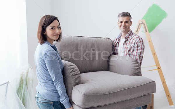 Couple moving furniture in their new house Stock photo © stokkete