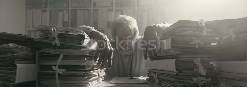 Stressed overloaded office worker Stock photo © stokkete