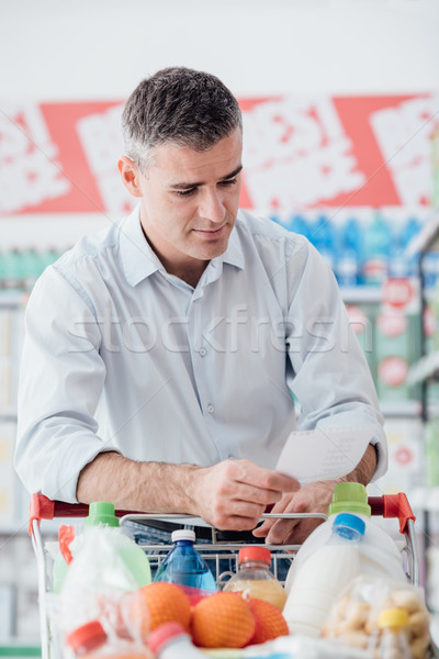 Man shopping with a grocery list Stock photo © stokkete