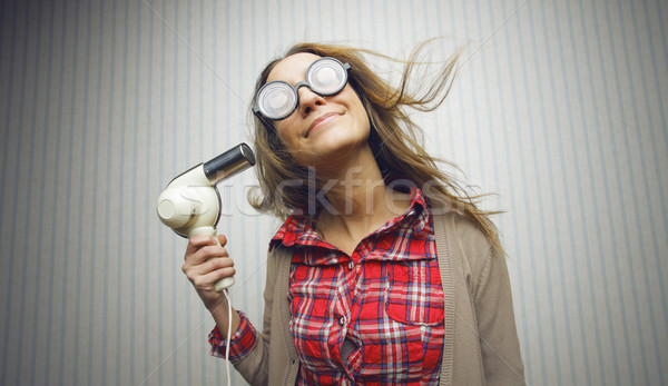 Nerdy woman drying hair Stock photo © stokkete
