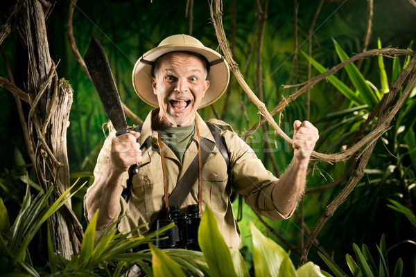 Cheering survival explorer in the jungle Stock photo © stokkete