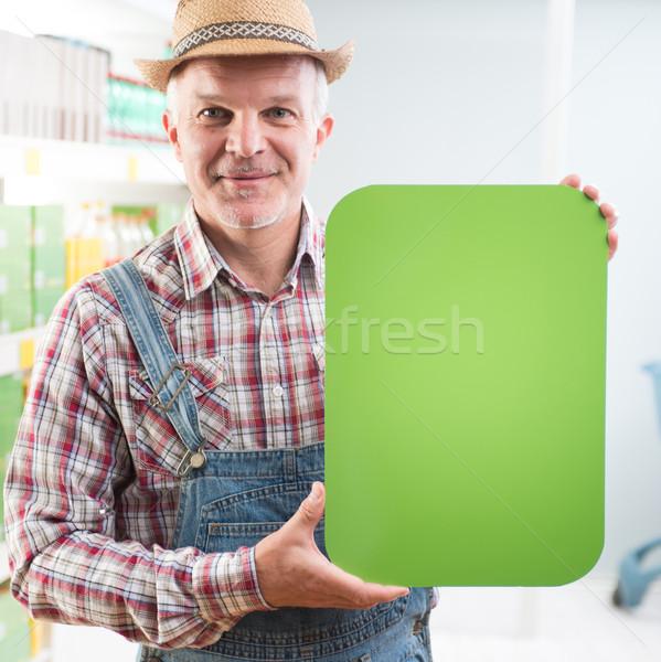 Farmer holding sign at supermarket Stock photo © stokkete