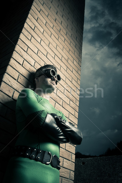 Cool superhero leaning to a brick wall Stock photo © stokkete