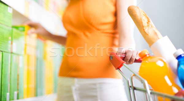 Woman choosing products at supermarket Stock photo © stokkete